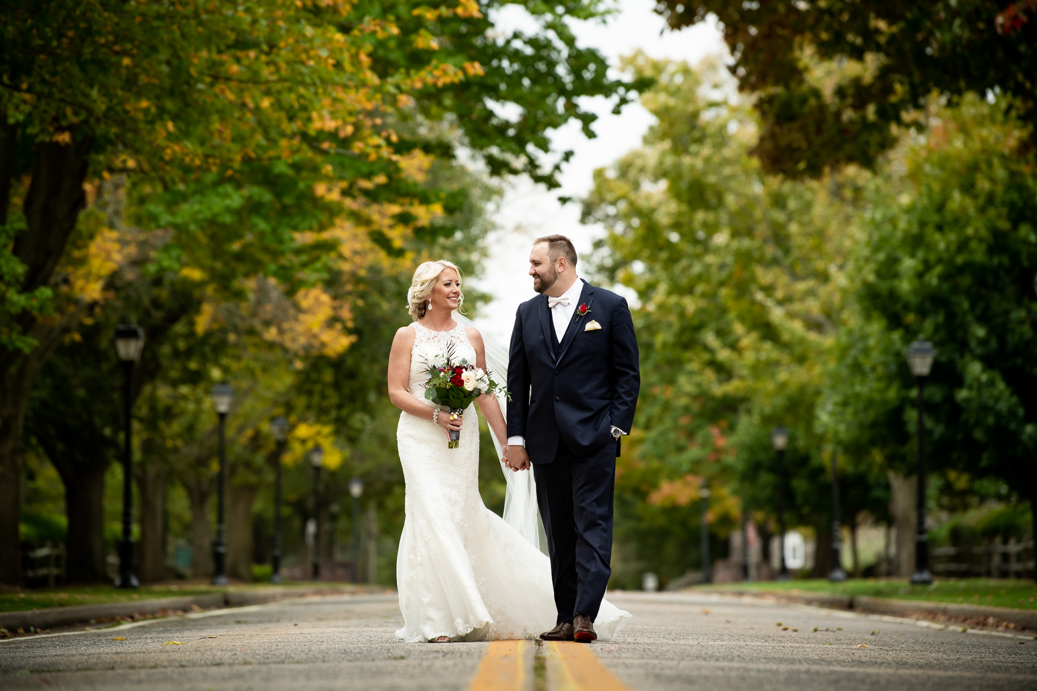 Couple walking together on their wedding day | Lotus Wedding Photography