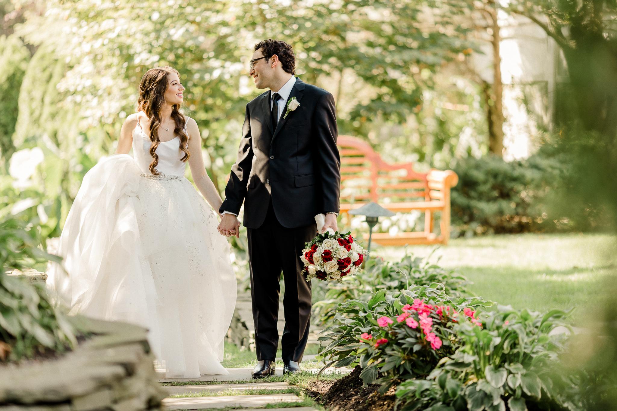 Happy bride and groom taking a walk | Lotus Wedding Photography