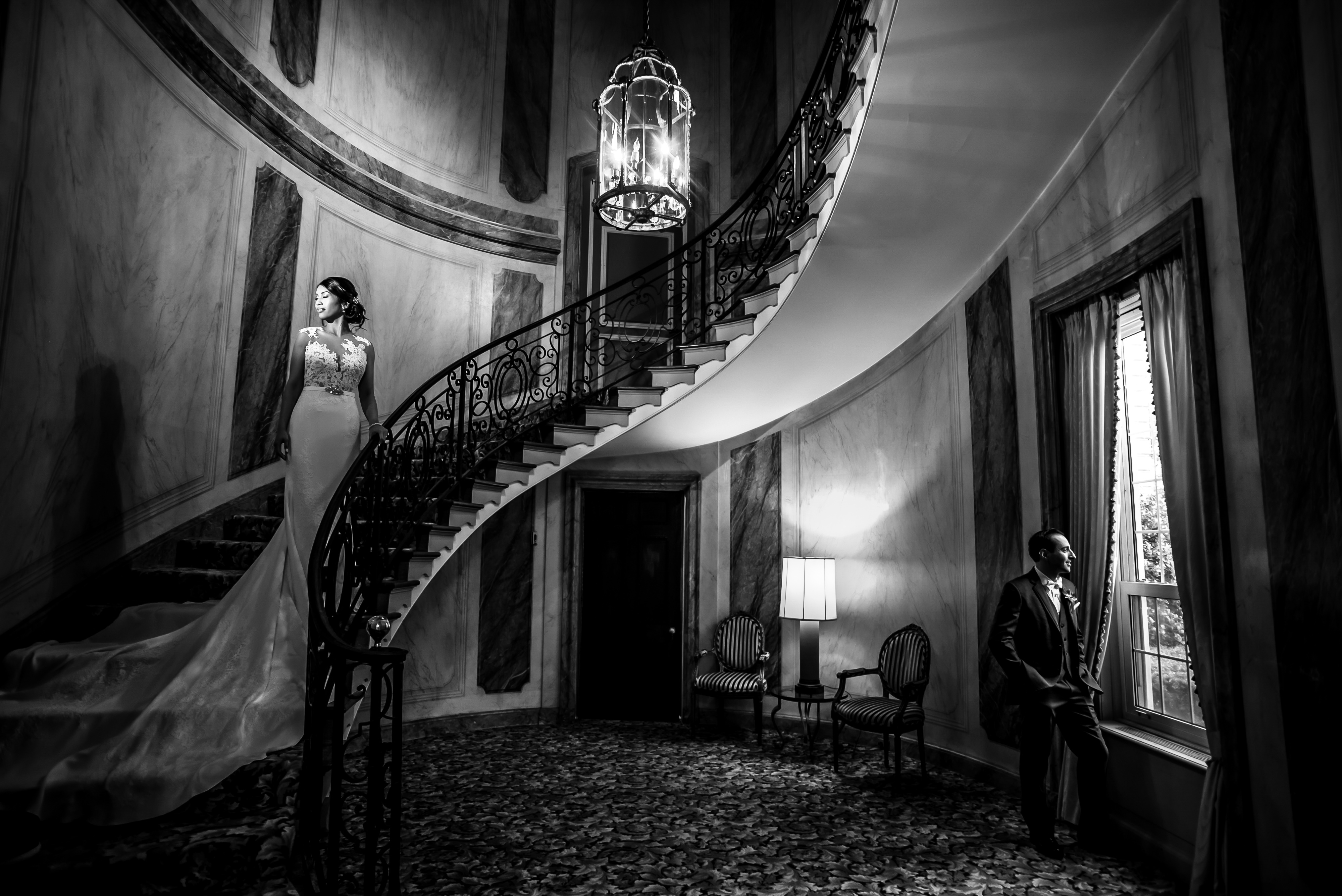 Bride on Winding Staircase at Pine Hollow Country Club | Lotus Wedding Photography