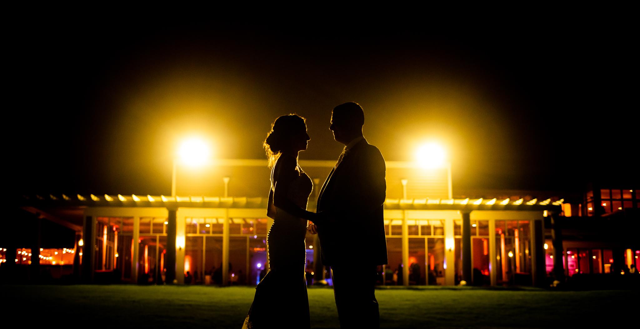 Couple celebrating their nighttime wedding reception | Lotus Wedding Photography