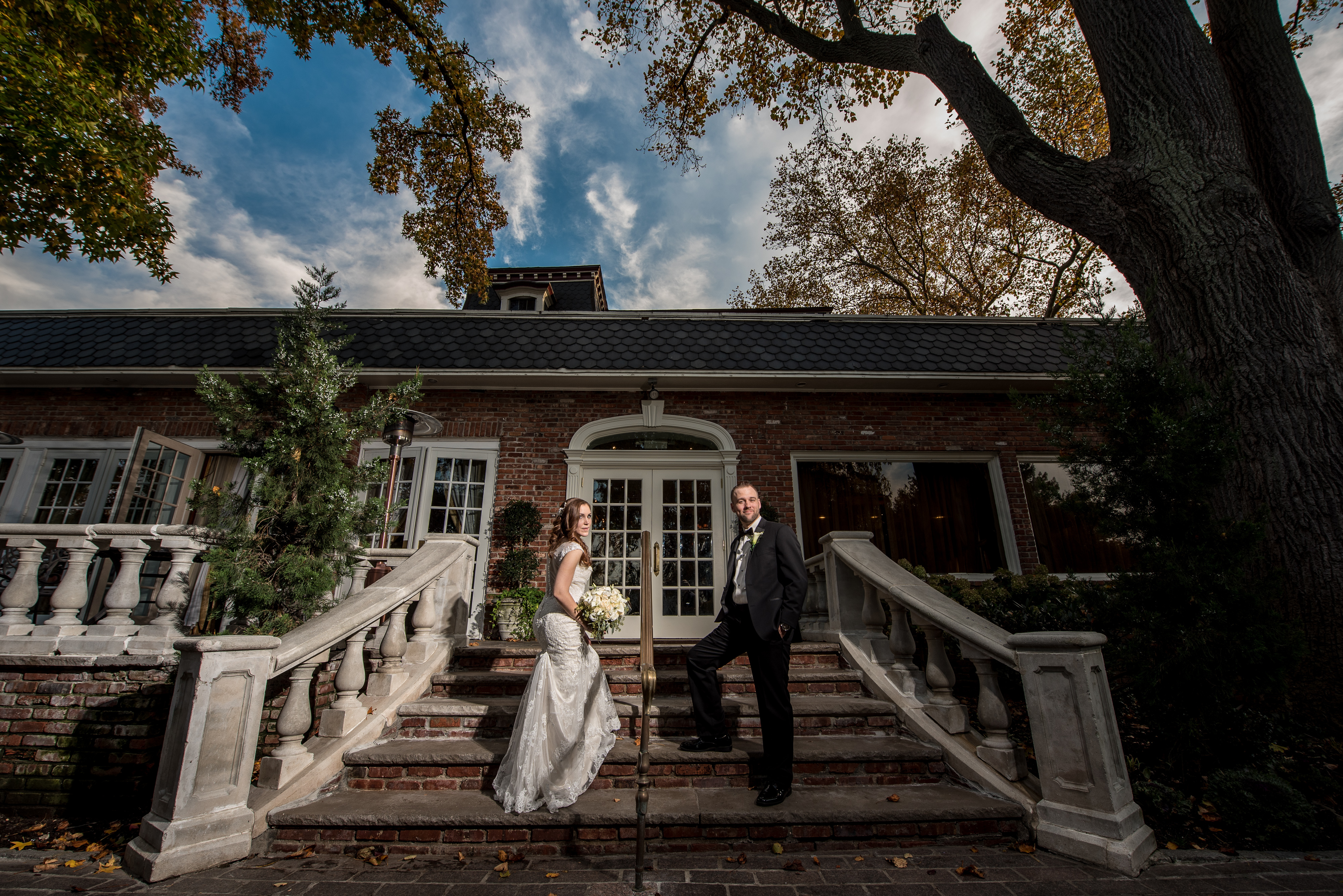 Bride and Groom Stand at Stairs | Lotus Wedding Photography
