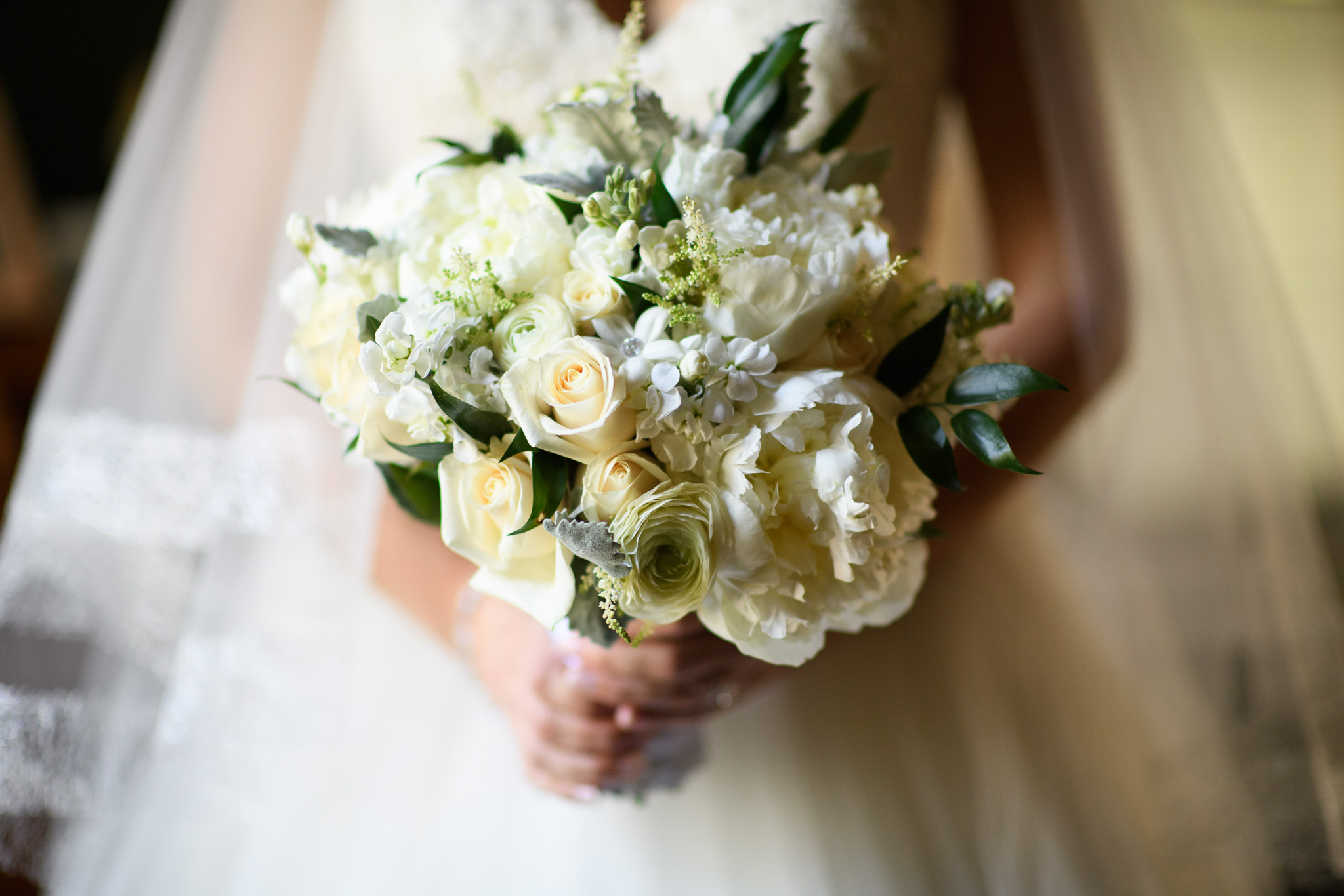 Bride holding bouquet of wedding flowers | Lotus Wedding Photography